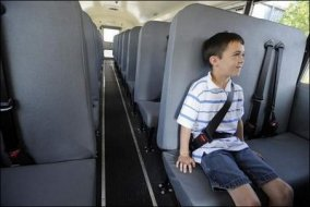 This school bus has seat belts that go both over your thighs and across your chest.