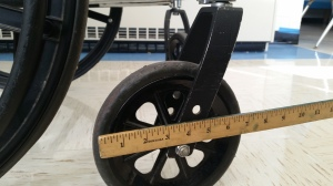 The front wheels of a standard wheelchair.