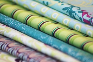 The picture demonstrates a variety of fabrics. Picture taken from http://artgalleryfabrics.typepad.com/