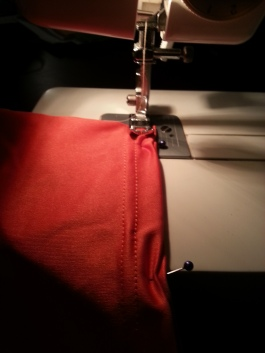 Here is the fabric being sewn onto the Ziploc bag for the rough draft of the prototype.