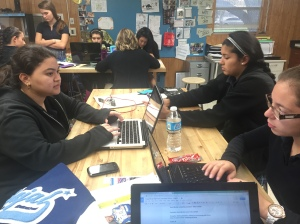 Group members Ana (left), Idalis (back right), and Savannah (front right), working on power point and google sketch up.