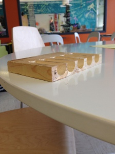 This is the wooden pedal that was created with the grooves in the Maker Space. The wooden balls go into the grooves.