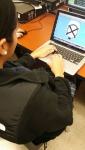 Idalis is working on the hard hat design on a program to piece it all together.
