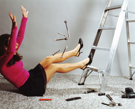 http://www.gettyimages.com/detail/photo/woman-falling-from-ladder-to-floor-by-tools-high-res-stock-photography/200189277-001