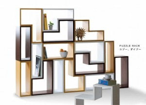 Our idea of a cubby that contains different sizes. Courtesy of http://decorlavie.blogspot.com/2010/03/tetris-puzzle-rack.html