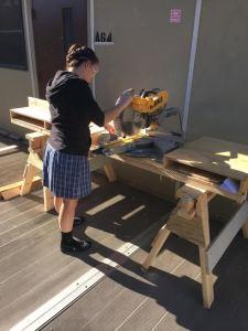 Stephanie using the miter saw