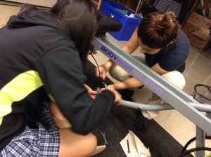 Yuvia and a Grecia disassembling the rowing machine. PC: Nelly C.