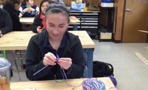 Stephanie casting on her first row of knitting