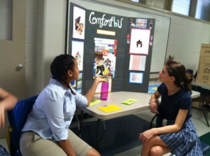 Team members Deanna, and Gabriela presenting our final prototype and information.